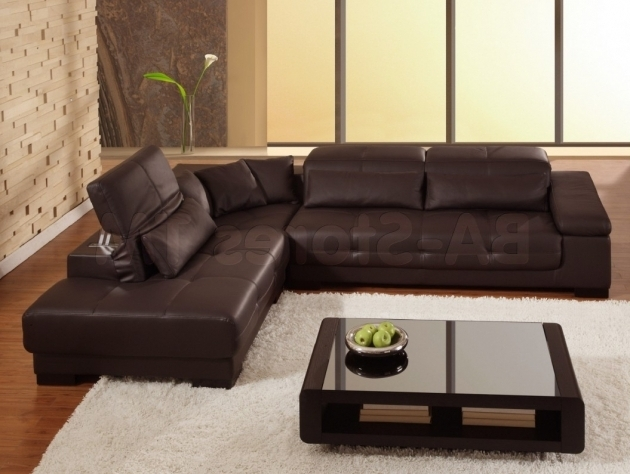 Brown Leather Sectional With Chaise And Cushions Also Glass Low Living Table On White Soft Carpet Design Photo 09