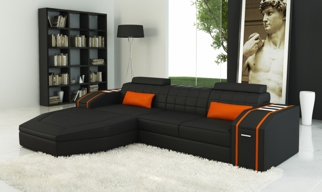 Modern Faux Black Leather Sectional With Chaise Bed And Orange Pillows Photo 37
