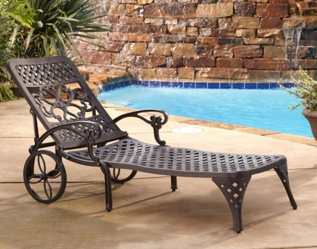 Vintage metal wrought iron chaise lounge chairs with for Black wrought iron chaise lounge
